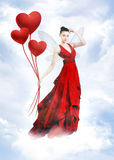 Atractive love fairy in clouds. Love fairy. Atractive brunette as love fairy with heart balloon on cloud Stock Photos