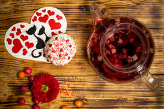 Love family celebration, fruit tea, flowers, sugar cakes, wooden table Stock Image