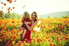Love and family, happy mother and child in poppy field stock photos