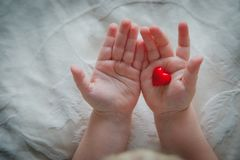 Love and family. little baby holding heart in hands. Valentine concept royalty free stock photo