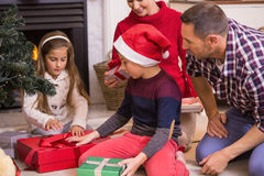 Love family opening gifts at christmas Stock Photography