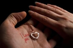 Love-favour with two hands Royalty Free Stock Photos