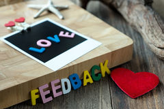 Love feedback message on Blank instant photo Stock Photography