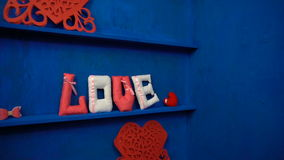 Love from felt letters on blue background stock footage