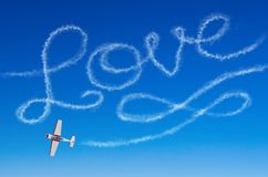 Love figurative inscription from a white smoke trail airplane.  Stock Photo