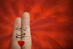 Love Fingers. Two fingers with drawings of faces and a heart Royalty Free Stock Images