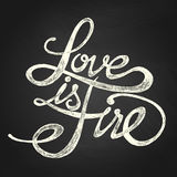 Love is Fire - Phrase. Hand drawn quotes, white flat drawing on chalkboard Royalty Free Stock Photo