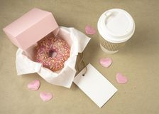 Love at first bite. Creative valentine concept photo of donut with take away coffee on brown background Stock Photos