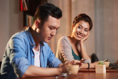 Love at First Sight in Cafe. Portrait of smiling Asian women looking lovingly at stranger men in cafe Royalty Free Stock Photos