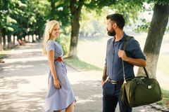 Love at first sight concept. Man and woman. Likes each other. Man with beard and blonde girl stopped to get acquainted. Casual encounter, meet on sunny summer stock photography