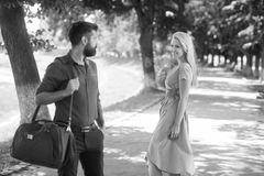 Love at first sight concept. Man and woman. Love at first sight concept. Man and women likes each other. Man with beard and blonde girl stopped to get acquainted stock photo