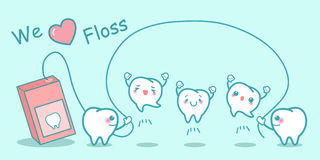 We love floss. Cute cartoon tooth with floss Stock Photo