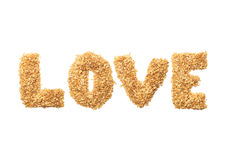 `LOVE` fonts with oat grains word. Shape of oatmeal flakes on isolated white background royalty free stock image