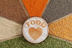 Love food concept - plant based food with diverse grains and seeds stock image