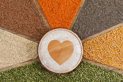 Love food concept - plant based food with diverse grains and seeds stock photos