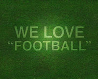 We love football on grass. Soccer field have text on grass We love football Royalty Free Stock Image