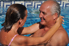 Love Forever. A middle-age couple is enjoying good time together during summer season. They are smiling each other, really happy Stock Photography