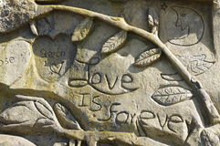 Love is forever. Expression of tender affectionate human feeling modelled in short-lived sand art sculpture Royalty Free Stock Photos