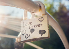 Love forever padlock with lens flare Stock Image