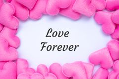 LOVE FOREVER word with pink heart shape decoration background. Love, Wedding, Romantic and Happy Valentine' s day holiday stock images
