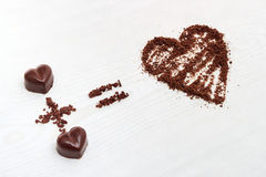 Love formula concept. Two chocolate candies make big love for chocolate. Stock Photo