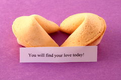 Love Fortune Cookies. Fortune cookies in heart shape predicting love on purple background royalty free stock image