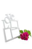 Love frame, rose on white background Stock Photos