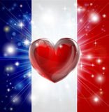 Love France flag heart background. Flag of France patriotic background with pyrotechnic or light burst and love heart in the centre Royalty Free Stock Images