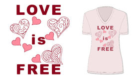 Love is free with hearts on pink t-shirt Stock Photo