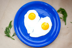 Love, fried eggs heart shaped Royalty Free Stock Photos