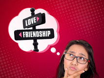 Between Love and Friendship. Conceptual image of a thoughtful young woman in confusion to choose between love and friendship Royalty Free Stock Photos