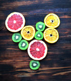 Love fruit, heart from slices of citrus fruit on wooden background Royalty Free Stock Photography