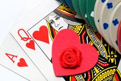 Love gamble. Poker cards with gambling chips and a heart shape/rose. Concept for love to gamble or choice between gamble or romance royalty free stock image