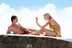 Love games on the beach. Young beautiful couple are playing on the beach stock image