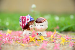 Love in the gardens. Dolls love in the gardens Stock Photos