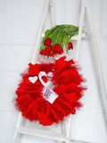 Love garland and red flowers Royalty Free Stock Image