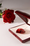 Love gift. Stone heart in the gift box with rose in background Royalty Free Stock Images