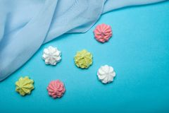 Love gift - air meringues on a blue background. The concept of sweet summer. View from above stock photos