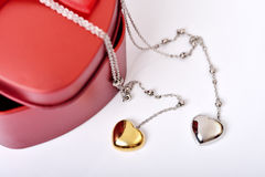 Love Gift Box. Red heart gift box and heart necklace on white background Stock Images