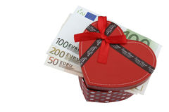 Love gift with Euros (EUR). Love gift with Euro (EUR) bills, in a red box shaped as a heart Royalty Free Stock Photos