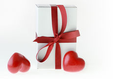 Love gift and red hearts Stock Images