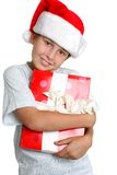 Love Gift Time. Young child holding a Christmas present Stock Photo