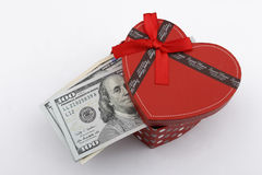 Love gift with US dollars (USD). Love gift with US dollar bills (USD), in a red gift box Royalty Free Stock Photography