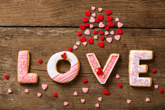 Love gingerbread with cloud of hearts Stock Photos