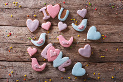 Love gingerbread cookies on a wooden table. Horizontal top view Royalty Free Stock Image
