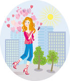 An in love girl gets tender SMS by phone Royalty Free Stock Photo