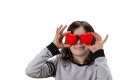 This is love! girl holding heart in front of his eyes and smilin Stock Image
