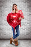 Love girl hugging big red heart Royalty Free Stock Image