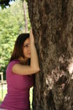 Love. Girl & tree. Girl embracing tree. Protect and love nature. Portrait. Protect environment Royalty Free Stock Photo