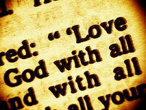 Love God - highest commandment. Close up view on a part biblical commandment of unconditional love to God and the neigbour. Focusing on the words: Love - God Stock Photography